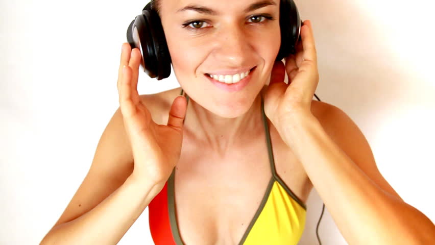 Attractive woman in bikini with headphones, slow motion