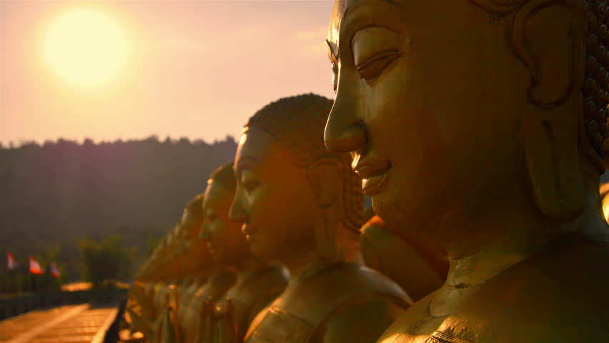 Golden Buddha and the light of the sun. The Buddha Memorial Park, Nakhon Nayok, Thailand : Dolly shot.High quality footage - original size 4k 3840x2160