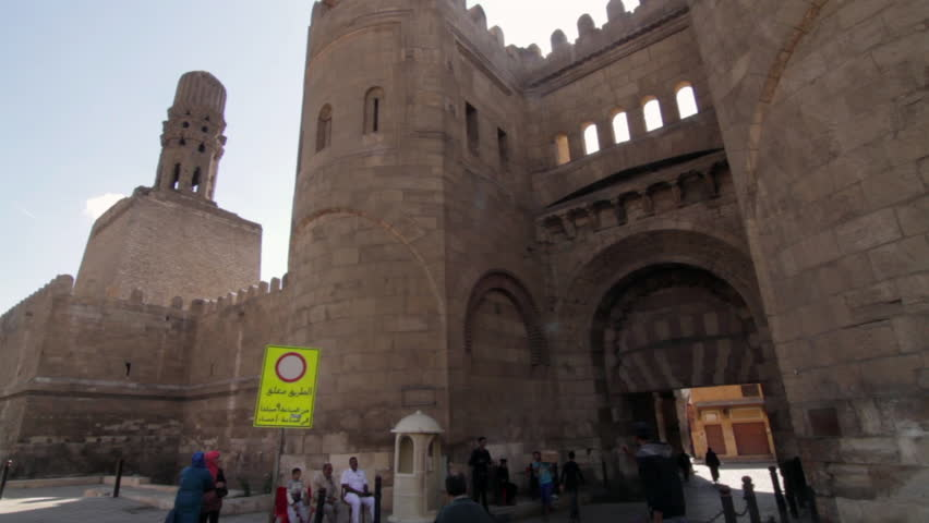 CAIRO, EGYPT - NOVEMBER 16, 2012: People near an entrance to the Al-Azhar Mosque. Minaret in the background. 1080p HD with natural sound. | Shutterstock HD Video #8449702