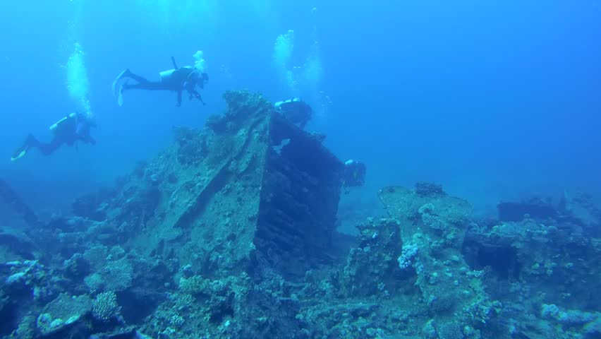 Scuba divers inspect the wreckage of wreck ship SS Carnatic in Red Sea, Egypt