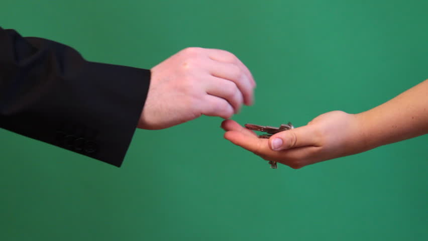 Hands show a process of buying a house