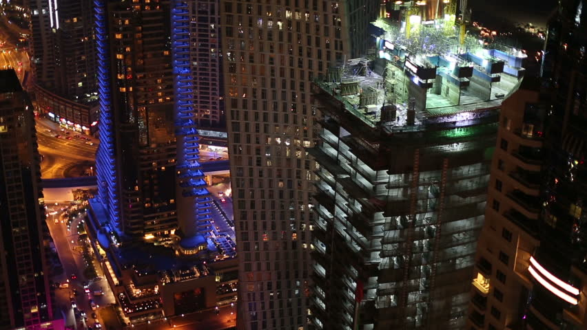 aerial view new skyscraper construction zone in Dubai at night #8563492