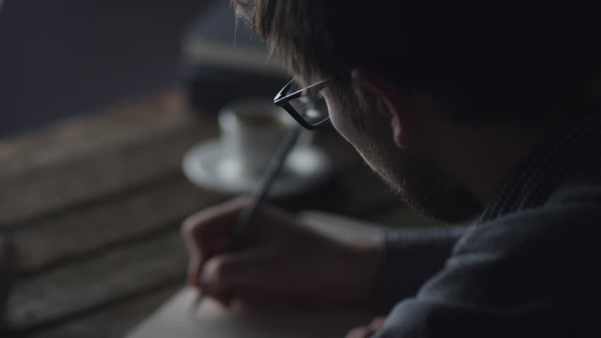 Designer is Scetching UI Design in Notebook at Evening. Causal Lifestyle. Shot on RED Cinema Camera in 4K (UHD). ProRes codec  - Great for editing, color correction and grading