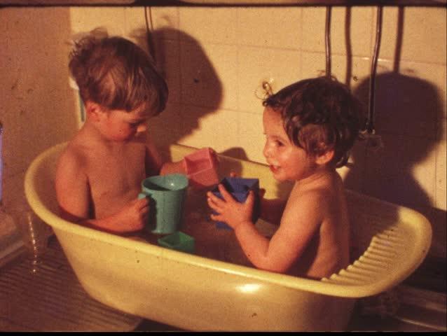 Boy and girl in washing tub (vintage 8 mm amateur film)