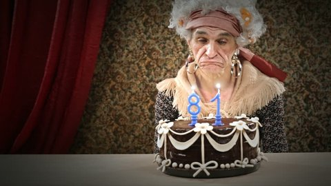 Funny senior woman is celebrating her birtHDay having fun with her birtdhay cake - HD video footage