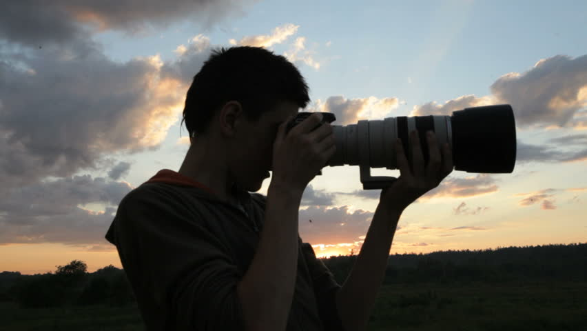 Boy With A Camera At Sunset - Silhouette Stockvideos ...