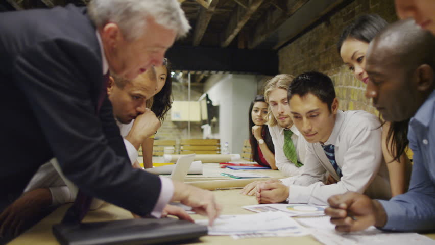 4K Mixed ethnicity business team in boardroom meeting in modern office | Shutterstock HD Video #8741212