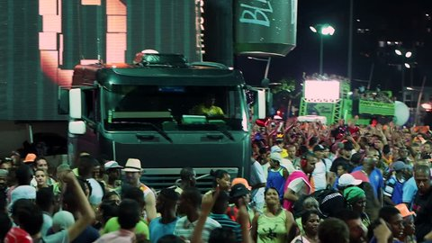 SALVADOR, BRAZIL - FEBRUARY 7, 2015: Crowd partying around Trio Eletrico (music truck equipped with sound system with band playing on the roof) during Carnival 2015 in Salvador, Bahia, Brazil.