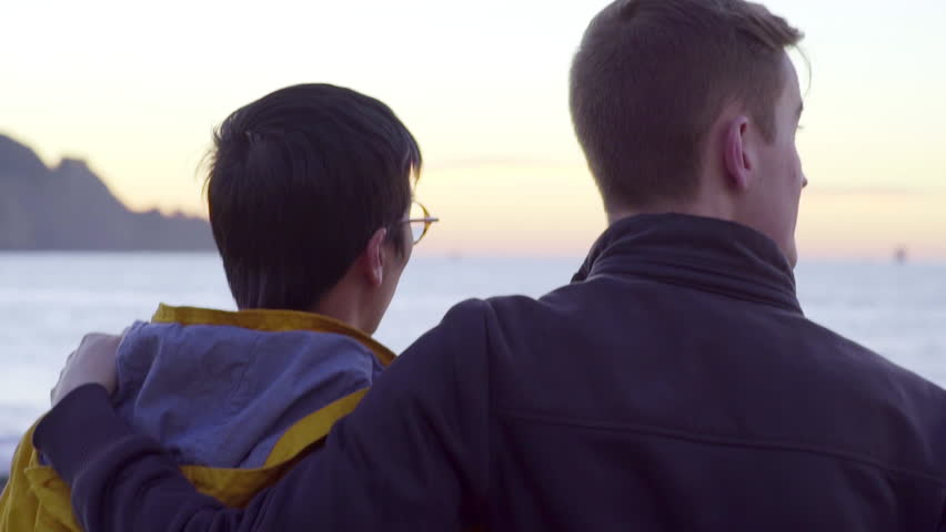 Gay Couple On Romantic Date, Watch Sunset And Kiss, In San ...