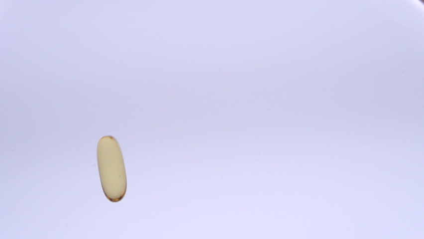 Medical pills falling down. Omega-3.  Medicine concept.  Full HD slow motion 1080p | Shutterstock HD Video #8932531