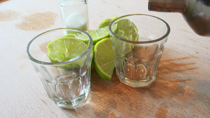 pouring tequila shots 4K #8951770