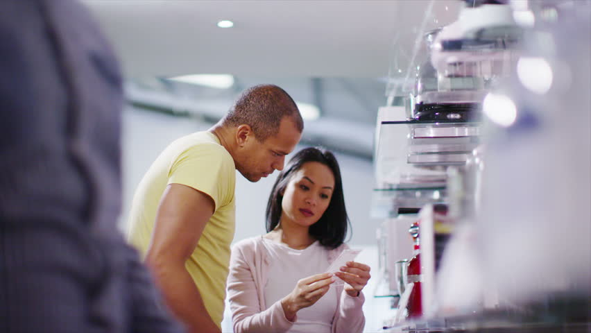 4K Couple shopping in a store selling kitchen appliances, white goods & electronics | Shutterstock HD Video #8983813