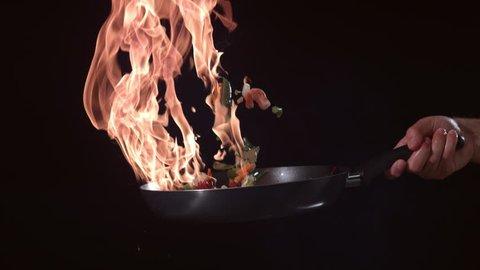 Flaming stirfry in slow motion; shot on Phantom Flex 4K at 1000 fps