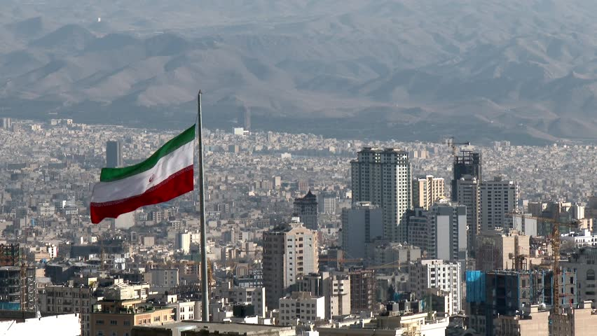TEHRAN, IRAN JANUARY 2015: Iranian flag in the middle of Tehran city. | Shutterstock HD Video #9009949