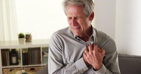 Mature man having heart attack
