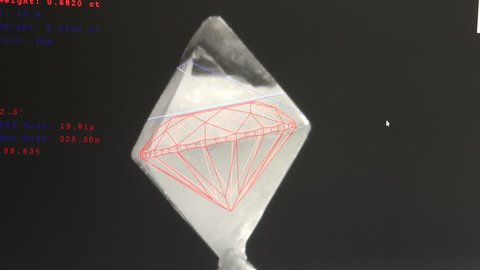 Rough diamond being computer analyzed for the highest yield, plotting the highest amount of cut diamonds.