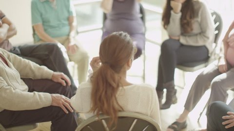 4K People in group therapy session talk about their problems together