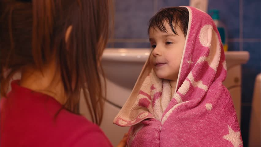 Mom Wipes Her Girl in a bathroom. Shot in RAW. Color Correction in Davinci Resolve.
