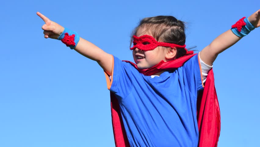 Superhero child (girl) runs in a green field against dramatic blue sky background with copy space. concept photo of Super hero, girl power, play pretend, childhood, imagination. | Shutterstock HD Video #9175202