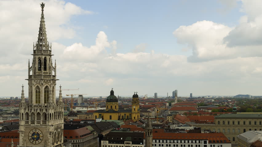 Panoramic view of Munich city center with the City Hall and the Frauenkirche, Germany. Zooming in timelapse video.