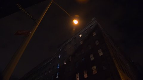 NEW YORK CITY - CIRCA 2015 - Wide low angle shot of a New York or Brooklyn apartment complex in a warehouse district at night.