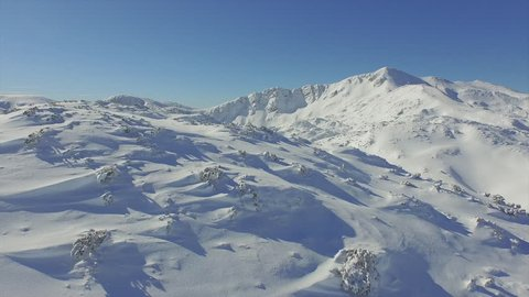 AERIAL: Snowy mountains in winter
