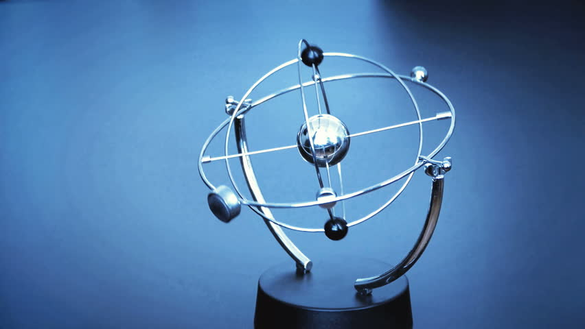 Spinning perpetual motion executive desk sculpture