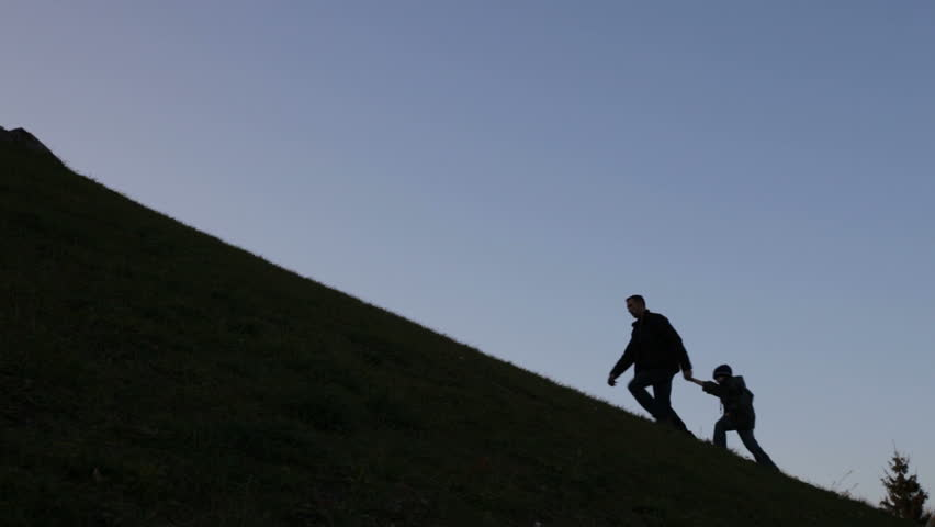 Father and son climbing uphill, metaphor | Shutterstock HD Video #926932