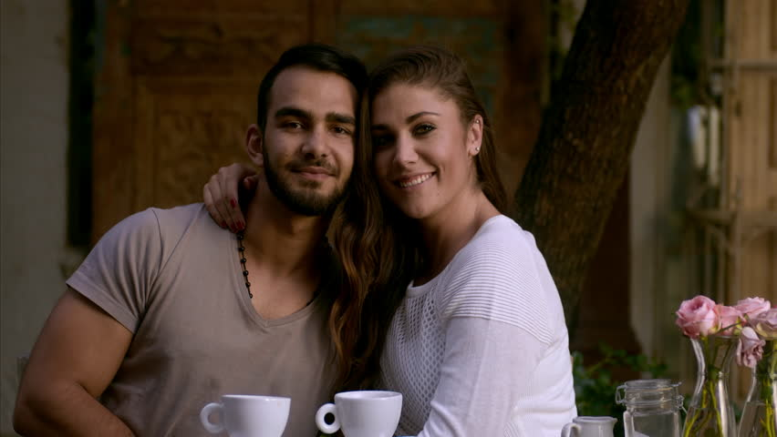 Dating couple smiling at camera while at coffee cafe. - 4K stock footage  clip