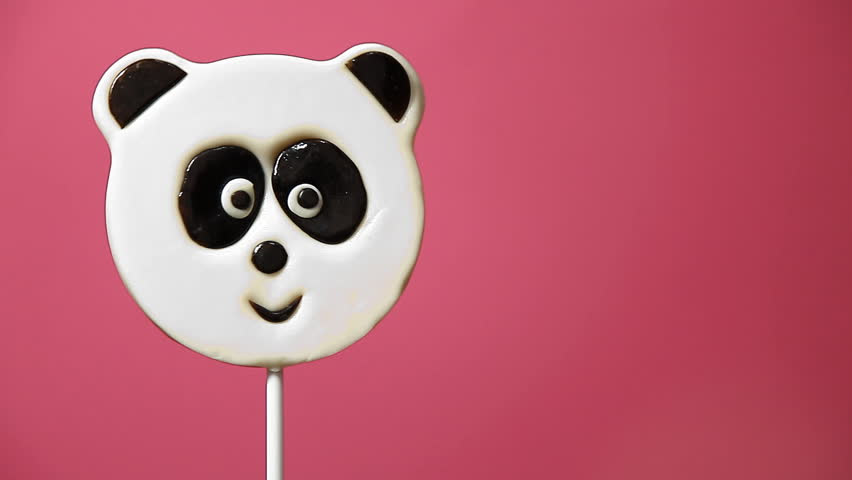 Lollipop in the form of an panda on a pink background | Shutterstock HD Video #9288152