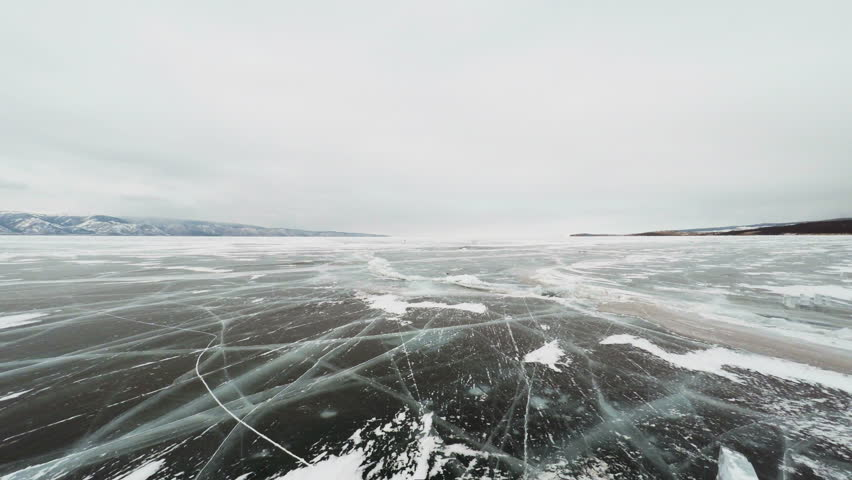 Flying Over Lake Baikal,   Frozen lake covered with a thick layer of ice