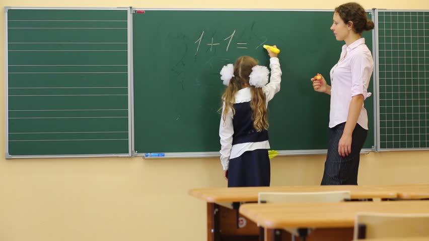 Girl And Teacher Near Chalkboard Stock Footage Video 100 -4240