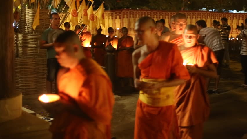 CHIANGMAI, THAILAND - FEBRUARY 25: Unidentified Thai monks meditate around Buddha statue among many lanterns at Phan Tao temple in Magha Puja Day on February 25, 2013 in Chiang Mai, Thailand.