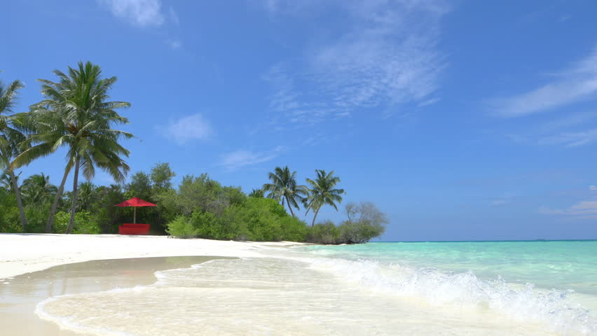 Empty daybed in exotic white sand lagoon | Shutterstock HD Video #9322442