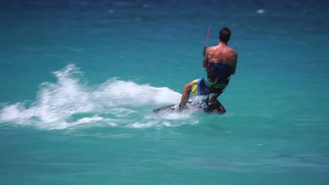 Extreme Sport Kite Boarding on the Ocean in Anguilla - Fit Athlete Performs Stunts in the Caribbean