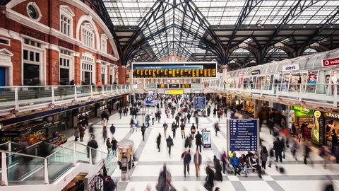 LONDON, UNITED KINGDOM - APRIL 9, 2013: Time lapse of Commuters inside Liverpool Street Station. The annual rail passenger usage between 2011 - 2012 was 13.835 million.