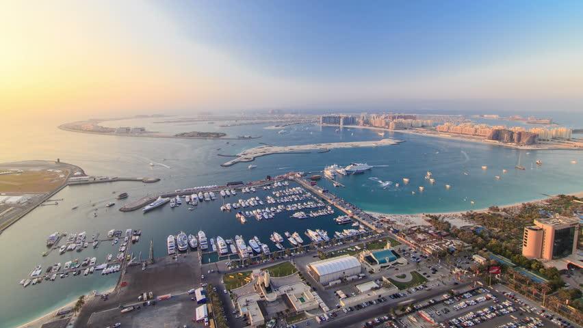 Dubai Marina wide angle Panorama evening time at sunset timelapse before light turn on 4K palm jumeirah