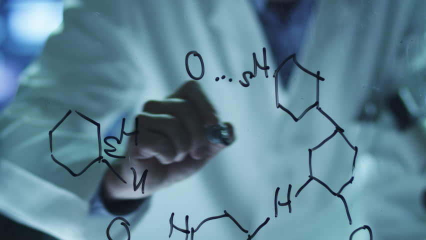 Scientist is Drawing Organic Chemical Formulas on Glass. Shot on RED Cinema Camera in 4K (UHD).
