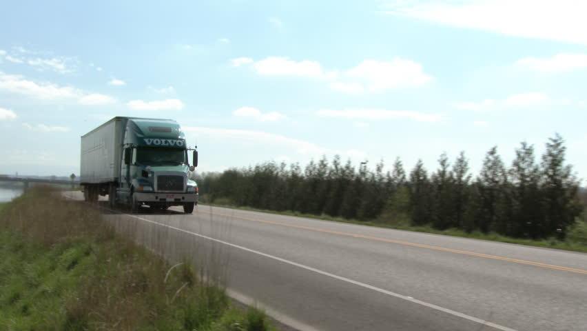 PORTLAND, OREGON - CIRCA 2015: Volvo semi truck drives by on country road.