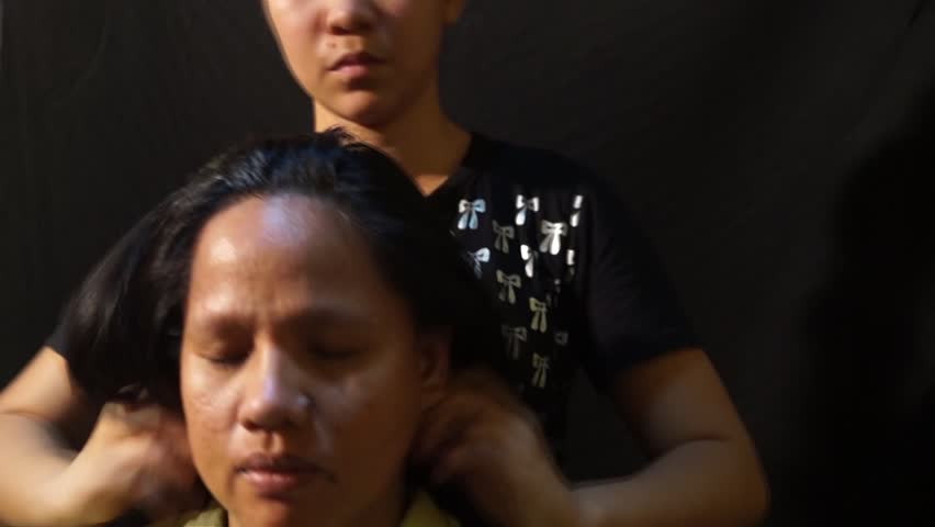 SAN PABLO CITY, LAGUNA, PHILIPPINES - JUNE 22, 2013: Lady masseuse shows how to massage head, face and hair | Shutterstock HD Video #9411692