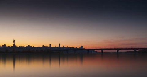 Time lapse footage of Kiev Pechersk Lavra, Patona Bridge on the Dnieper river, Mother Motherland, lights of urban Kiev at evening. Ukraine, Eastern Europe, romantic.