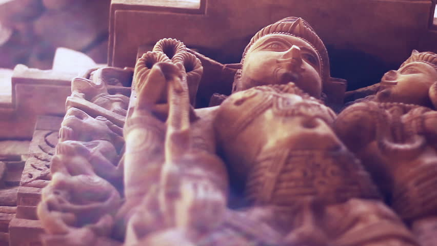 Sandstone sculptures of a Jain temple in Jaisalmer, Rajasthan, India. Shallow depth-of-field.