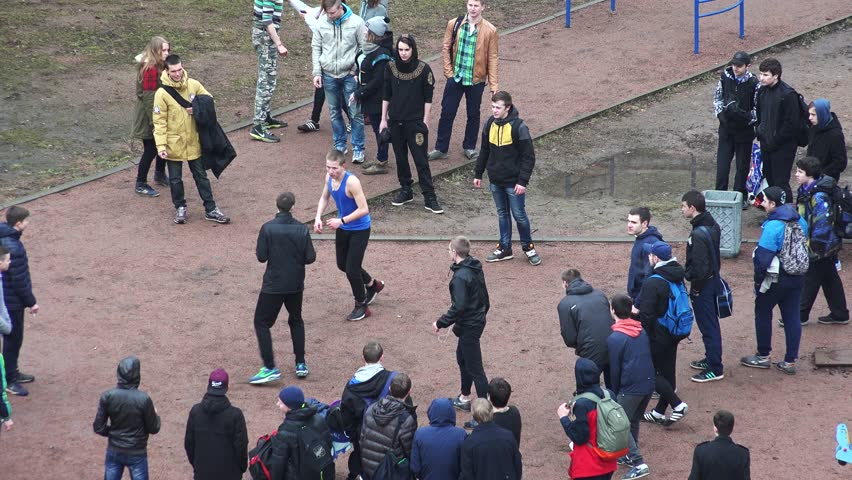 SAINT-PETERSBURG, RUSSIA - APRIL, 2015: A fight teenagers on the street in the yard. Shot in 4K (ultra-high definition (UHD, so you can easily crop, rotate and zoom, without losing quality! Real time.