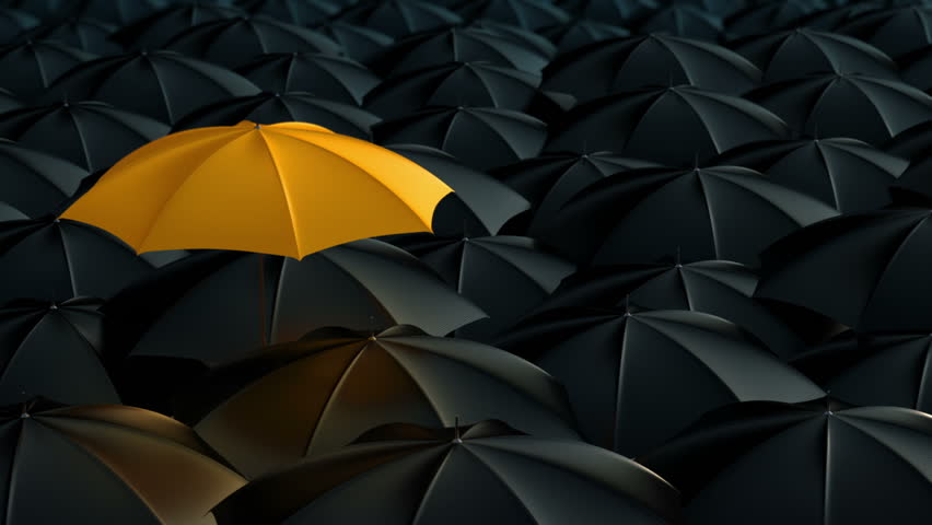 Yellow umbrella open and standing out from crowd mass black umbrellas, design background text concept, high point