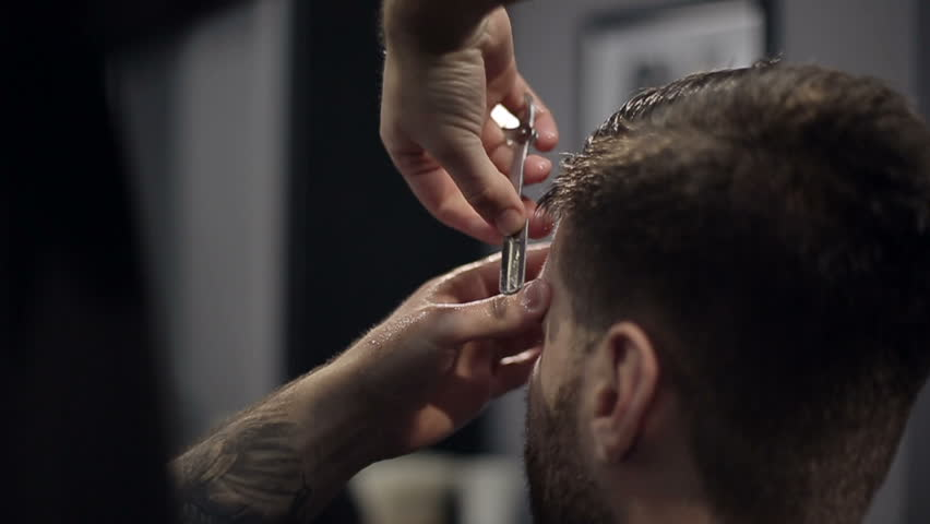 Barber Cuts the Hair in the Barbershop. Slow Motion. Close Up