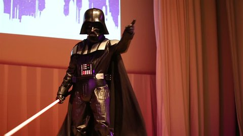MOSCOW, RUSSIA - MARCH 28, 2015: Star Wars fan dressed as Darth Vader on stage during the festival Star Fans.