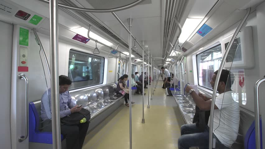 Mumbai, India -March 31, 2015: Mumbai Metro train running and commuters sitting & standing in the metro. Comfortable, modern , fast, new & air conditioned transport in Mumbai India, March 31, 2015. | Shutterstock HD Video #9659939