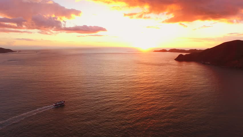 San Francisco Aerial v5 Flying low backwards over the Golden Gate Bridge at sunset.   Shutterstock HD Video #9663182