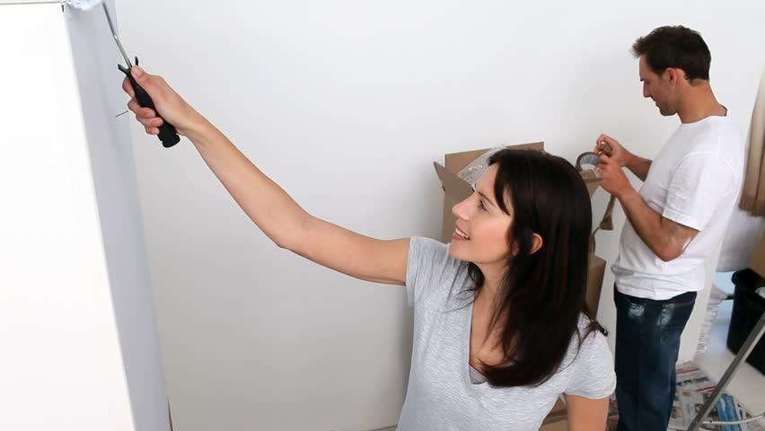 Couple painting a big wall white in a bedroom at home | Shutterstock HD Video #967252