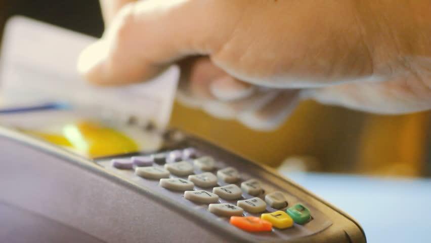 Credit card swipe through terminal machine  | Shutterstock HD Video #9678662